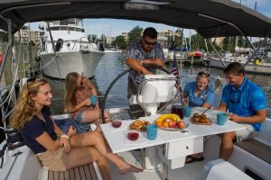 Picture of Family in Sailboat Enjoying a Meal - PC: SailTime Billy Black Photography